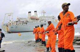 Workers haul part of a fibre optic cable onto the shore at the Kenyan port town of Mombasa