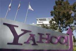Yahoo 2Q profit up 8 pct, yet ad slump continues (AP)