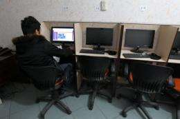 An Iranian man surfs the internet at a cafe in centeral of Tehran