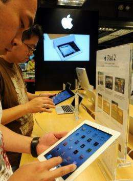 Customers check out the newly released Apple iPad 2 in Hong Kong