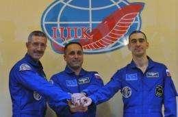 (L-R) US astronaut Dan Burbank and Russian cosmonauts Anton Shkaplerov and Anatoly Ivanishin