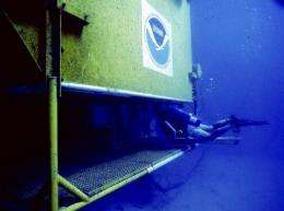 This undated file image obtained in 2003 shows a diver entering the Aquarius underwater habitat