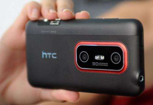 A model displays the HTC Evo 3D,during a press conference in Taipei