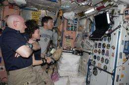 2 space crews mark 1 week together in orbit (AP)