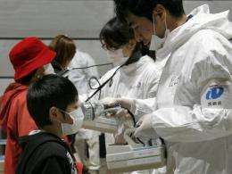 A boy receives a radiation scan at a screening center in Koriyama in Fukushima prefecture in March