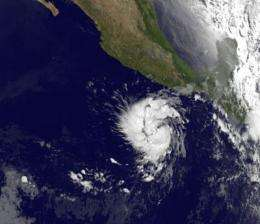 A double-satellite NASA-style view of the first tropical storm in eastern Pacific: Adrian