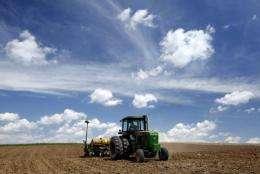 A farmer plants corn in Luxemburg, Iowa