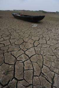 A fishing boat lies on the dried up bank of the Chaohu lake