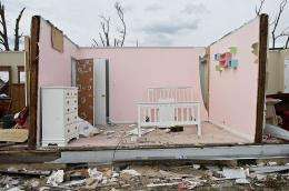 A girl's room is exposed in a destroyed house