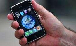 A man displays an iPhone