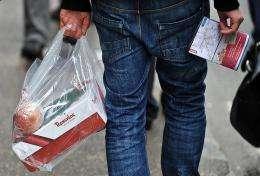 A man holds a plastic bag