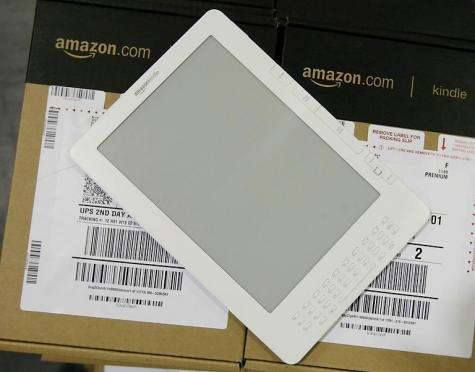 Amazon on Monday introduced a cut-price version of its Kindle electronic reader that features on-screen ads