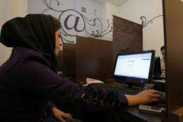 An Iranian woman surfs the Internet at a cyber cafe in central Tehran