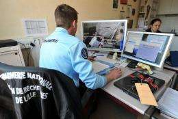 A policeman in Lille, France, works on cyber crime