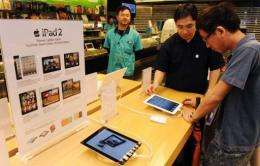 Apple's four stores in Beijing and Shanghai have begun selling the Wi-Fi model of the lighter, thinner iPad 2