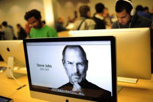 """Apple turned its home page into a tribute with a picture and the caption """"Steve Jobs, 1955-2011"""""""