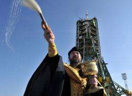 A Russian Orthodox priest blesses the Soyuz TMA-22 spacecraft at Russia's Baikonur cosmodrome