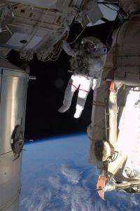 Astronaut eager for 1st look at wife from orbit (AP)