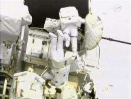 Astronauts take 3rd spacewalk for laying cable (AP)