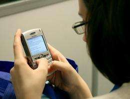 A woman sends text messages in Washington, DC