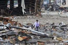 A woman visits Kesennuma, Miyagi prefecture, on June 18, 100 days after a massive earthquake and tsunami struck Japan