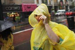 A woman walks down the street in the rain on September 6, in New York City