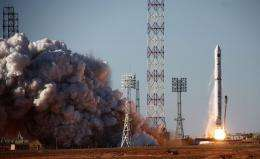 A Zenit 3F rocket carrying the Spektr-R radio astronomy observatory blasts off from Baikonur cosmodrome