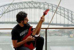 Brazilian guitar soloist Paulo Calligopoulos, with the Sydney Harbour Bridge in the background