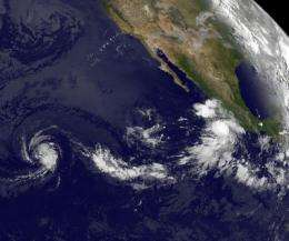 GOES-11 satellite sees Tropical Storms Fernanda and 'little brother' Greg chasing each other