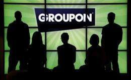 Groupon raises $700M with IPO at $20 per share (AP)