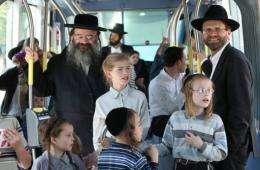 Israelis enjoy a ride as Jerusalem's light rail system begins operating in central Jerusalem today