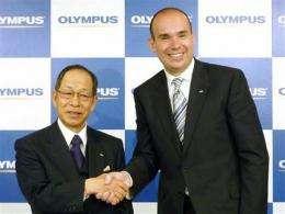 Japan insurer reduces scandal-ridden Olympus stake (AP)