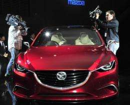 "Japan's auto giant Mazda Motor displays the concept mid-sized sedan ""Takeru"""