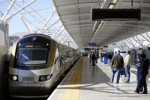 Passengers wait to board the Gautrain, Africa's first high-speed rail line in Pretoria today
