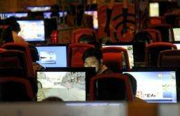 People surfing the Internet at a coffee shop in Beijing
