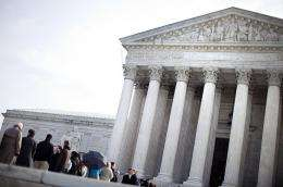 People wait to enter outside the US Supreme Court in March