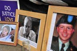 Photographs of Wikileaks founder Julian  Assange (C) and US serviceman Bradley Manning (R)