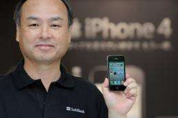 President of mobile phone carrier Softbank, Masayoshi Son displays a iPhone 4