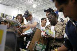 Shoppers crowd a Best Buy store