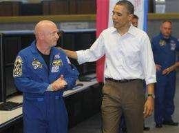 Shuttle flight is delayed; Obama visits Giffords (AP)