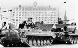 Soviet Army soldiers sit a top APCs in central Moscow on August 19, 1991, in front of the Russian White House