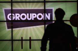The Groupon logo is displayed in the lobby of the company's international headquarters in Chicago