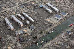 This aerial view taken during an AFP-chartered flight shows an area destroyed by the tsunami in Sendai