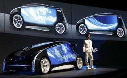 Toyota unveils high-tech concept car ahead of show (AP)