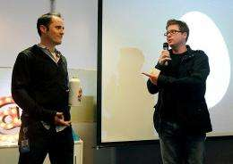 Twitter co-founder Biz Stone (R) and CEO Evan Williams