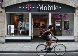 Under the deal, Telekom will get $25 billion in cash and $14 billion worth of AT&T shares