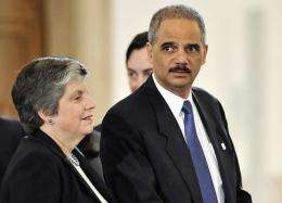 US Attorney General Eric Holder (R) and US Secretary of Homeland Security Janet Napolitano