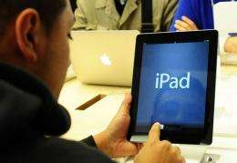 A customer tries the new Apple iPad at Apple's flagship store on Fifth Avenue