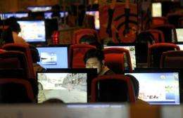 A man surfs the internet at a cafe in Beijing