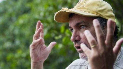 Brazilian biologist Mario Moscateli talks about pollution in the Marapendi lagoon on December 12, 2012